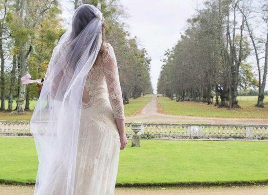 A bride looks out to Hale Park drive