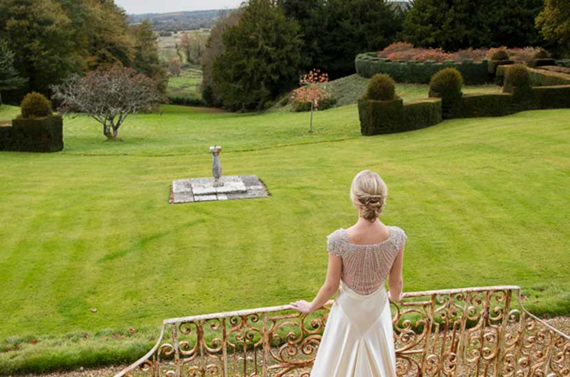 Bride looks over Hale Park grounds