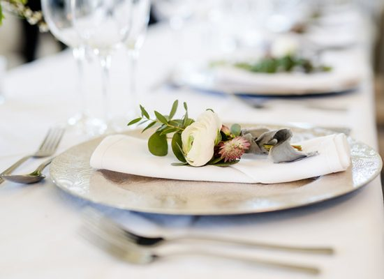 Table setting with floral napkin holder