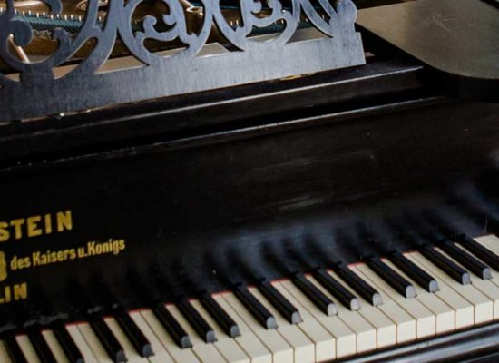 A piano forms the musical backdrop to a Hale Park wedding reception