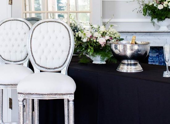Close up of bar chairs and champagne bucket
