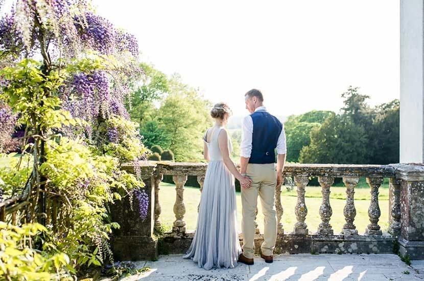 A bride and groom on Hale Park balcony