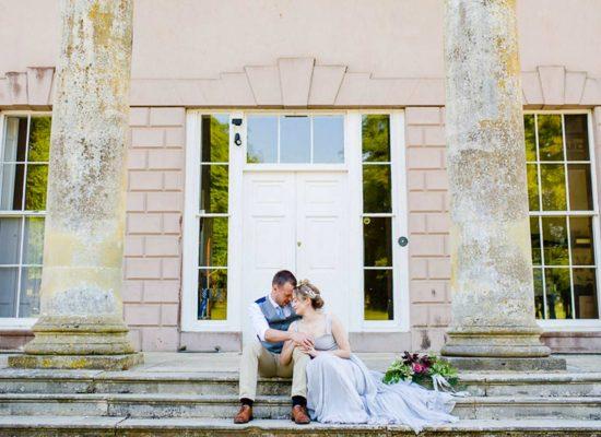 Bride and groom under Hale Park portico