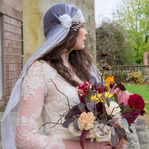 Bride with Autumn bouquet at Hale Park
